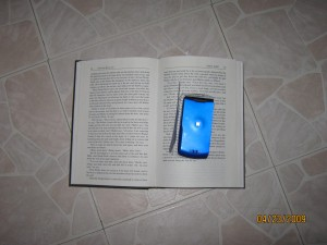 With some clear tape applied to a concealment flap made from the altered pages, the cell phone is undetectable to the untrained eye.